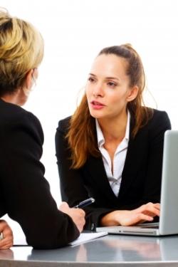 women in meeting listening