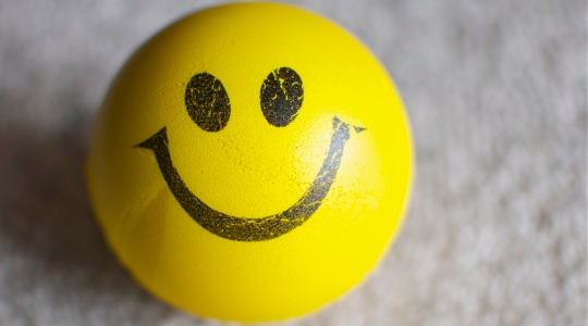 Yellow ball with happy face