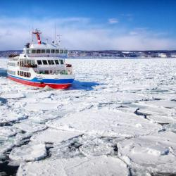 Ice breaker ship navigating through arctic waters