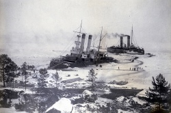 Old photo of two ice breakers near shore