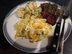 Dinner plate of steak, mushrooms, potatoes, zucchini slaw