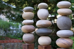 Sculpture of three stacks of smooth rocks