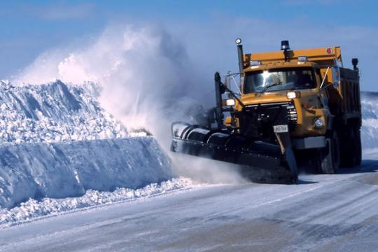 snowplow pushing snow down a street