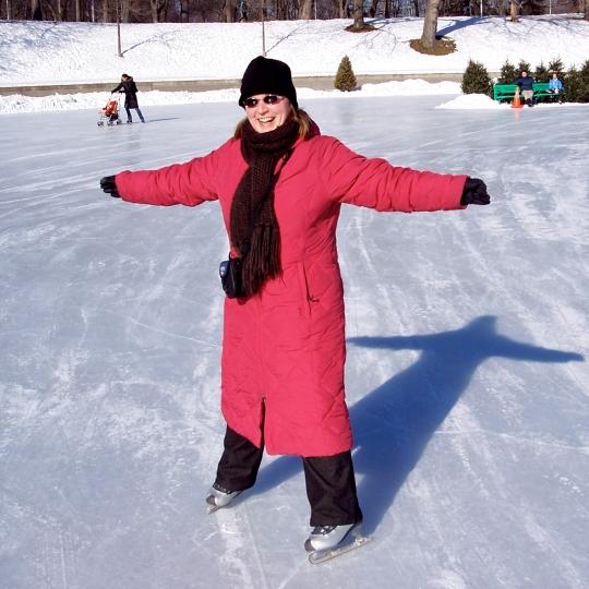 Woman in pink coat skating