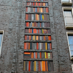 Bookshelf mural made of ceramic tile