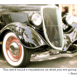 Black classic Ford roadster with quote from Henry Ford