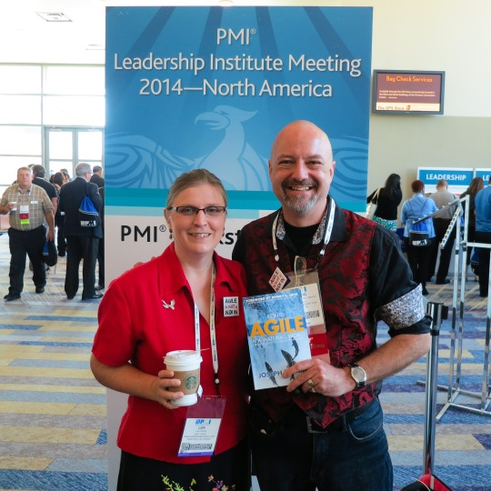 Joseph Flahiff holding book at PMI LIM